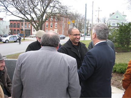 DA Soares Greeted By The Mayor, As Seen Over Dominick Calsolaro's Broad Shoulders