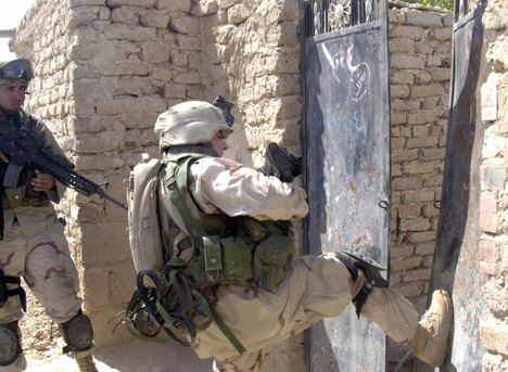 1st Infantry Soldier Kicks Open A Gate In Samarra, Iraq
