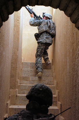 82nd Airborne Soldiers Climb To The Roof Of A House In Owja, Iraq