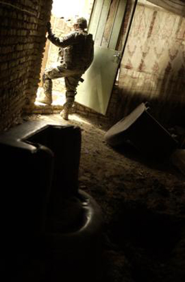 23rd Infantry Soldier Stands Guard At The Back Door Of A House In Rashid, Iraq