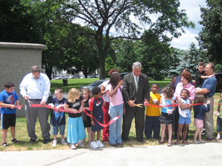 Dominick (at left) Demonstrates that He Can Cut Ribbons As Well As The Mayor (in suit)  (Click on photo for full size)