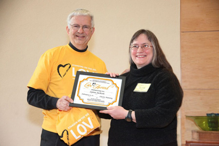 FUUSA Board President Chuck Manning Presents The Wife With The Standing On The Side Of Love Award... And A T-shirt