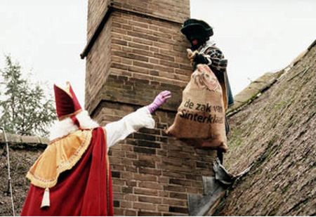 Black Pete Works While The Bishop Supervises