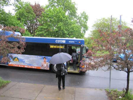 Commuters Catch The 100 Bus On A Rainy Morning In May, Morton Avenue