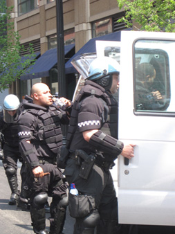 Riot Cops At White Vans Dressing In Armor