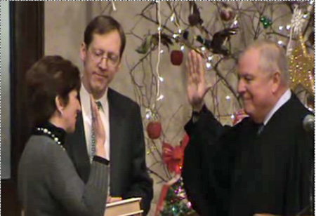 Kathy Sheehan Sworn In As Treasurer By Judge Anthony Cardona With Husband Bob Assisting, Dec. 31, 2009 (From ACT)