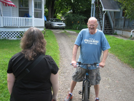 "Stan Knapp, Former Sidney Police Chief Called For Rescue When He Heard The Wife Scream.  Yes, His T-Shirt Reads, ""I'm Not A GYNECOLOGIST But I'll Be Glad To Take A Look."""