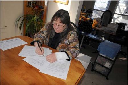 The Wife In Her Home Office Showing Paperwork To The Content Providers