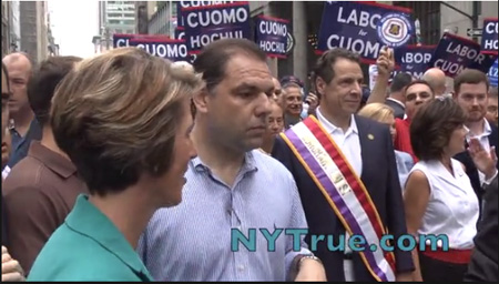 Ungracious Andrew Cuomo (With Sash) Pointedly Ignores His Primary Opponent Zephyr Teachout (Left) At A Parade In NYCUngracious Andrew Cuomo (With Sash) Pointedly Ignores His Primary Opponent Zephyr Teachout (Left) At A Parade In NYC