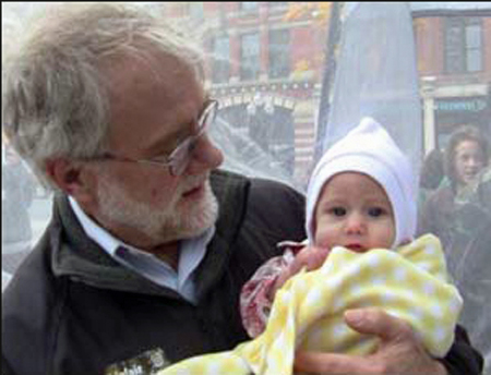 Howie Hawkins Does The Baby Thing While Campaigning Last July