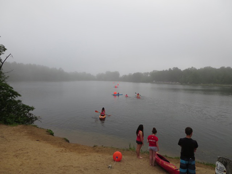 Lifeguards Head Out On Kayaks And Paddle Boards To Man Their Positions On Rensselaer Lake Before The Pine Bush Triathlon Begins