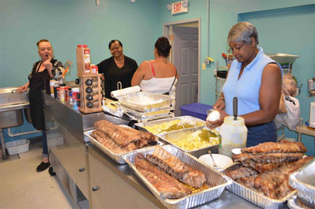Volunteers Prepare Traditional Southern Style Food For Mississippi Day (Photo From AVillage)