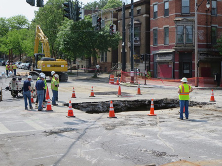 Frowning Guys In Hardhats Inspect The Hole At Madison And New Scotland Avenues
