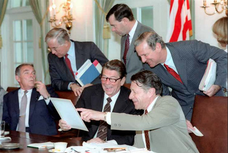 Radical Corporatist ideologue Ronnie Reagan With His Cabinet Of Handlers