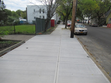 Freshly Laid New Sidewalk In Front Of The Site (Which The City Probably Shouldn't Have Done)