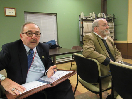 Water Commissioner Joe Coffey Explains To A Third Avenue Resident While Deputy Water Commissioner Bill Simcoe Listens