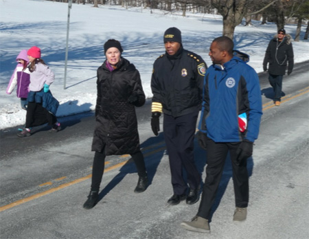 State Assembly Member Pat Fahy And Albany Police Chief Eric Hawkins Converse And Grimace, While Albany Recreation Commissioner Jonathan Jones Seems To Enjoy The Weather